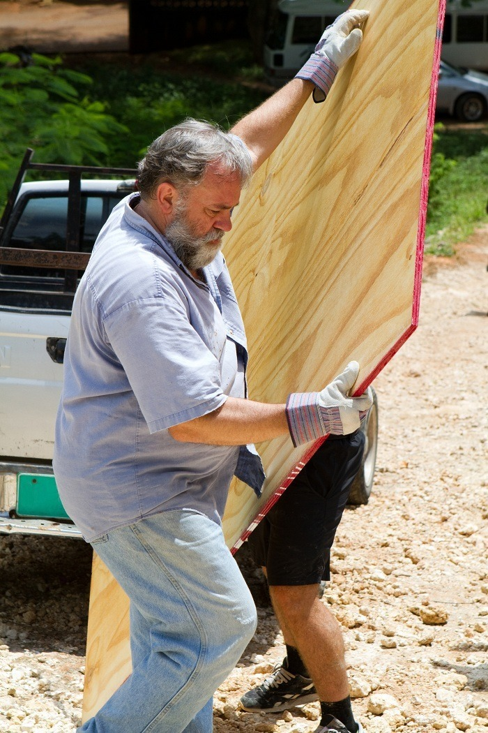 cabinet, grade, plywood, board, man, mature, carpenter, bearded, carrying, construction, gray, labor, laborer, lifting, lumber, male, manual, mature, pickup, truck, wood, worker, works
