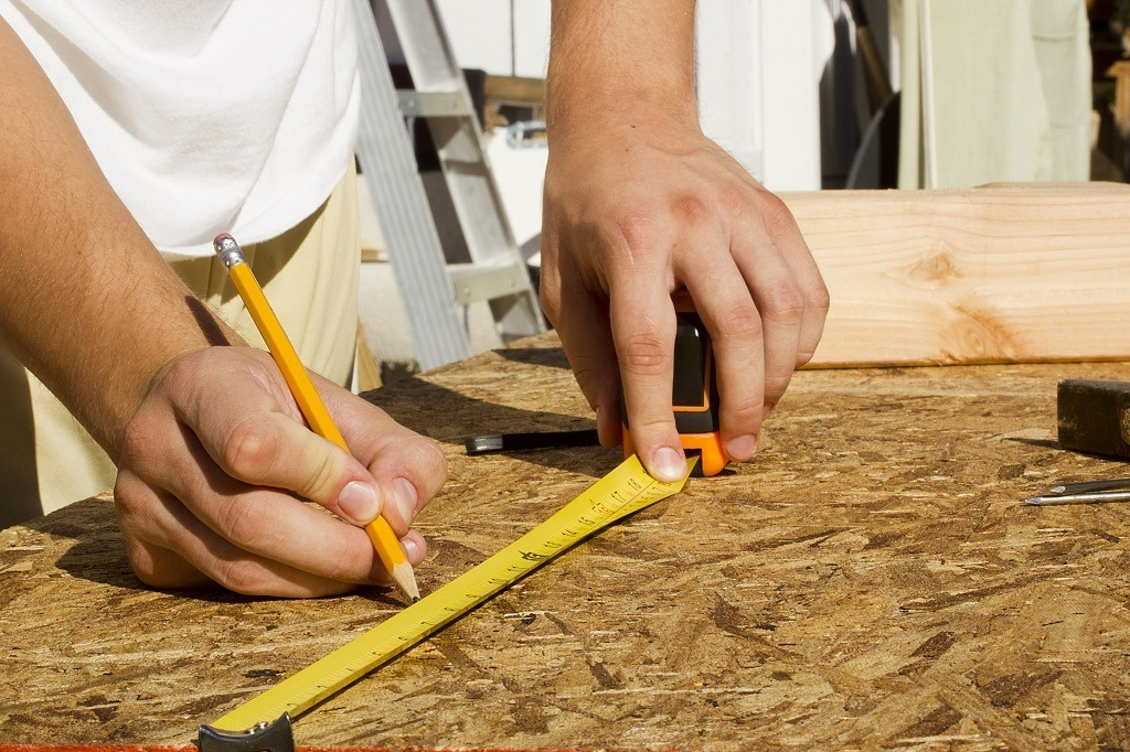measuring, OSB, wood, panel, hand, tape measure, distance, length, accuracy, building, carpenter, carpentry, caucasian, closeup, construction, contractor, device, equipment, hand, home, improvement, industrial, industry, instrument, male, pencil, repairing, ruler, tape, tool, white, wood, worker, working