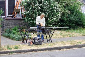 Compound miter saw, man, carpenter