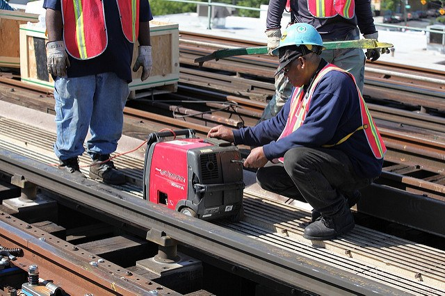 portable generator, workers, tracks