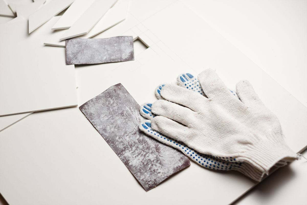 used sandpaper, gloves